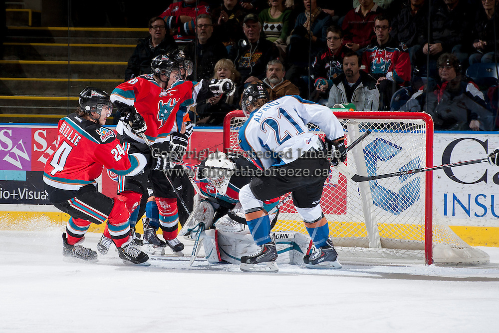 KELOWNA, CANADA - DECEMBER 7: Jackson Whistle #1 of the Kelowna Rockets makes a save against the Kootenay Ice on December 7, 2013 at Prospera Place in Kelowna, British Columbia, Canada.   (Photo by Marissa Baecker/Shoot the Breeze)  ***  Local Caption  ***