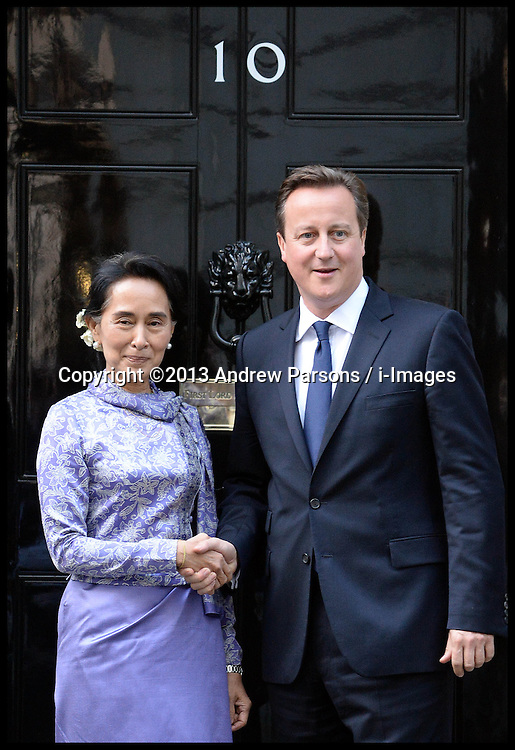 Aung San Suu Kyi  is greeted on the steps of No 10 Downing Street with The Prime Minister David Cameron as she visits London, United Kingdom. Wednesday, 23rd October 2013. Picture by Andrew Parsons / i-Images