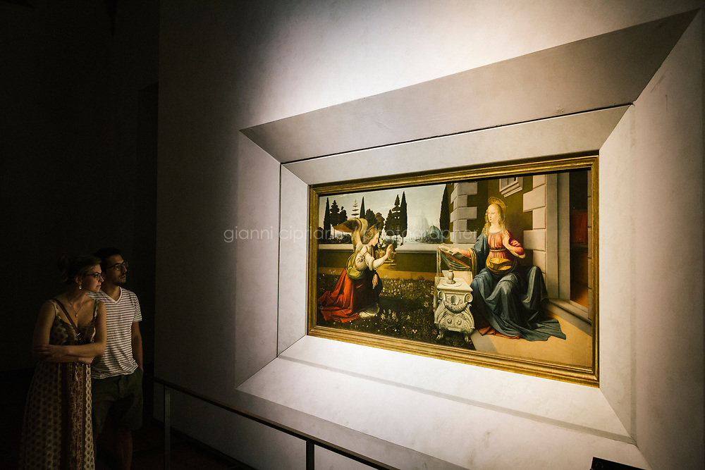 FLORENCE, ITALY - 3 JUNE 2018: &quot;Annunciation&quot; (1472-1475 ca) by Leonardo da Vinci, is seen here at the Uffizi, before being relocated next month to a new room, in Florence, Italy, on June 3rd 2018.<br /> <br /> As of Monday June 4th 2018, Room 41 or the &ldquo;Raphael and Michelangelo room&rdquo; of the Uffizi is part of the rearrangement of the museum's collection that has<br /> been defining Uffizi Director Eike Schmidt&rsquo;s grander vision for the Florentine museum.<br /> Next month, the museum&rsquo;s Leonardo three paintings will be installed in a<br /> nearby room. Together, these artists capture &ldquo;a magic moment in the<br /> first decade of the 16th century when Florence was the cultural and<br /> artistic center of the world,&rdquo; Mr. Schmidt said. Room 41 hosts, among other paintings, the dual portraits of Agnolo Doni and his wife Maddalena Strozzi painted by Raphael round 1504-1505, and the &ldquo;Holy Family&rdquo;, that Michelangelo painted for the Doni couple a year later, known as the<br /> Doni Tondo.