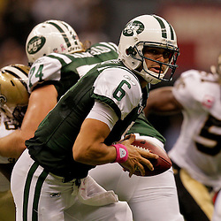 2009 October 04: New York Jets quarterback Mark Sanchez (6) looks to handoff during a 24-10 win by the New Orleans Saints over the New York Jets at the Louisiana Superdome in New Orleans, Louisiana.
