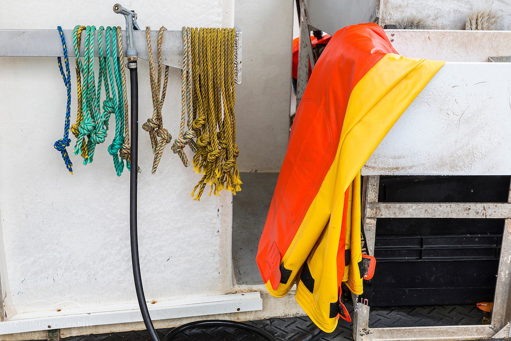 Rope and waders on a lobster boat at Potts Harbor Lobster in Harpswell, Maine.