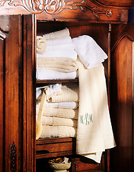 Antique wood linen and towel cabinet