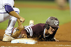Texas A&M's Joel Davis (17) beats a tag by TCU's Connor Wanhanen (16) at first base during the fourth inning of a NCAA college baseball Super Regional tournament game, Saturday, June 11, 2016, in College Station, Texas. (AP Photo/Sam Craft)