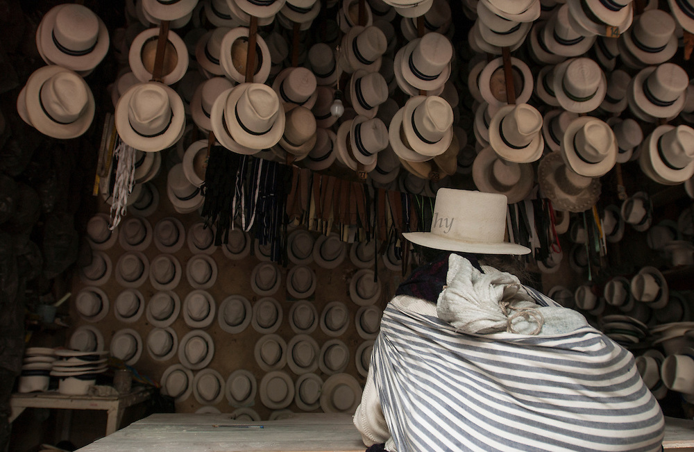 Customer in Cuenca Panama Hat Shop<br /> Panama Hats made from Toquilla Straw<br /> Cuenca<br /> Andes<br /> ECUADOR.  South America