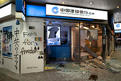 Hong Kong. 6 October 2019. Tens of thousands of pro-democracy protestors march in pouring rain through centre of Hong Kong today from Causeway Bay to Central. Peaceful march later turned violent as a hard-core of protestors confronted police. Pic; Vandalised China Construction Bank branch in Causeway Bay. Iain Masterton/Alamy Live News.
