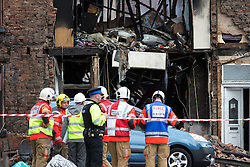 © Licensed to London News Pictures . 09/08/2016 . Manchester , UK . Scene on Curzon Road in Ashton Under Lyne in East Manchester where a house caught fire and there was an explosion early this morning . Ten people are reported injured , one seriously  . Photo credit : Joel Goodman/LNP