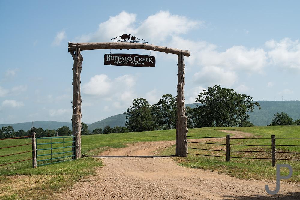 Entrance sign over Buffalo Creek Guest Ranch