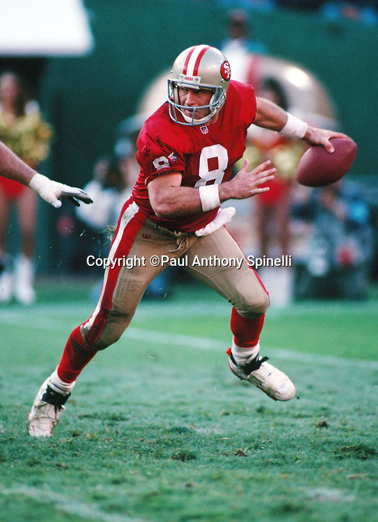San Francisco 49ers quarterback Steve Young (8) scrambles during the NFL NFC Divisional Playoff football game against the Green Bay Packers on Jan. 6, 1996 in San Francisco. The Packers won the game 27-17. (©Paul Anthony Spinelli)