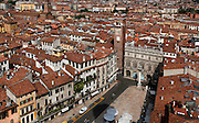High angle view of Piazza delle Erbe from the Lamberti tower, Verona, Italy. The Piazza delle Erbe (Square of Herbs) stands on the old Roman Forum, and remains the centre of city life. The 14th century Gardello Tower and the Baroque Palazzo Maffei are overlooking the square. Picture by Manuel Cohen.