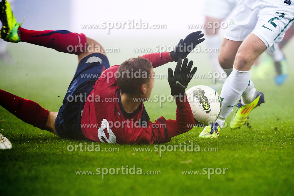 Miso Brecko of Slovenia trips Fabian Johnson of USA for penalty shot during friendly football match between National teams of USA and Slovenia, on November 15, 2011 in SRC Stozice, Ljubljana, Slovenia.  (Photo By Matic Klansek Velej / Sportida.com)