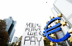 Power You Play We Pay Transparent the Protest movement Occupy Frankfurt next to the Euro symbol before the ECB European Central Bank Willy Brandt square Frankfurt M Hesse Germany Economy Crisis Economic crisis Protest politics. Photo By i-Images