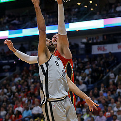 Apr 11, 2018; New Orleans, LA, USA; San Antonio Spurs guard Tony Parker (9) shoots over New Orleans Pelicans forward Nikola Mirotic (3) during the second half at the Smoothie King Center. The Pelicans defeated the Spurs 122-98. Mandatory Credit: Derick E. Hingle-USA TODAY Sports