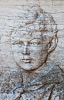 Bas relief sculpture of a boy on a grave in Isola San Michel in Venice, Italy.