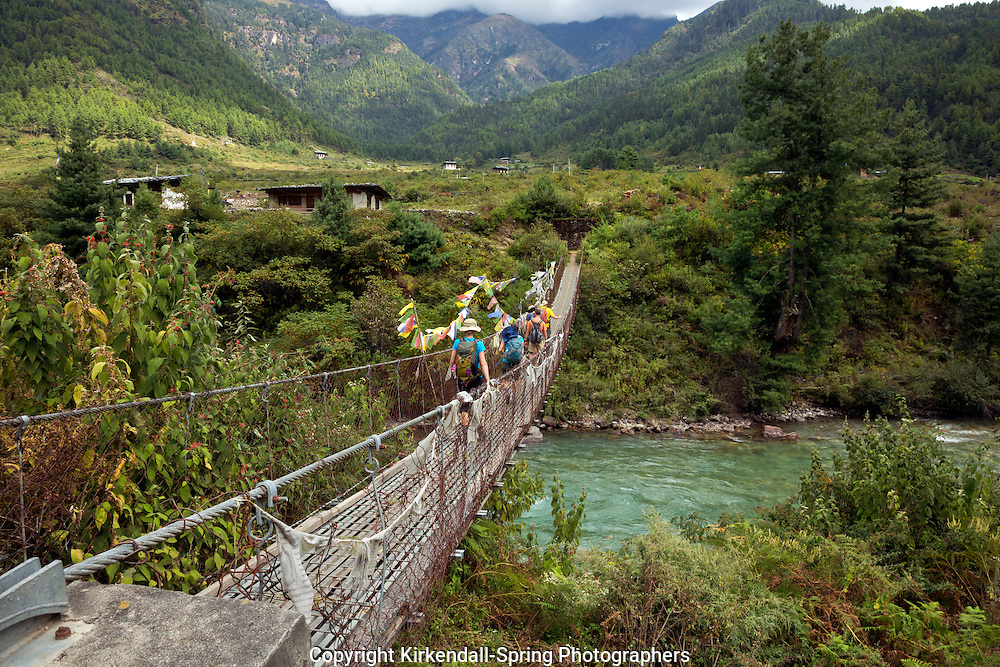 BU0014300...BHUTAN - Trekkers crossing the Paro Chhu (river) on the first day of walking on the Jhomolhari 2 Trek.