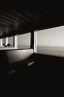 Ferry with lone passenger makes way toward Bainbridge Island, WA.  Copyright 2008 Reid McNally