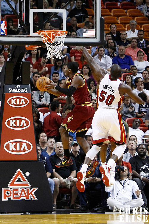 24 January 2012: Cleveland Cavaliers point guard Kyrie Irving (2) goes for the reverse lay up past Miami Heat center Joel Anthony (50) during the Miami Heat 92-85 victory over the Cleveland Cavaliers at the AmericanAirlines Arena, Miami, Florida, USA.