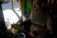 Some of the best restaurants in Kargil are the little dhaba's just off the main bazaar. Here a man drains some noodles for tukpa, a Tibetan soup.