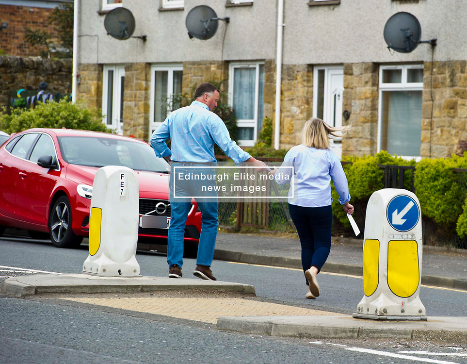 Pictured: <br /> <br /> Early voters head to the polls on John Street in Penicuik, Midlothian<br /> <br /> Ger Harley | EEm 8 June 2017