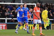 Joe Bunney congratulates  Nathaniel Mendez-Laing on his goal 3-0 during the Sky Bet League 1 match between Rochdale and Blackpool at Spotland, Rochdale, England on 16 April 2016. Photo by Daniel Youngs.