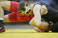 January 22 2010: Iowa's Matt McDonough tries to pin Ohio State's Bo Touris battle for control during the 125-pound bout an NCAA wrestling dual at Carver-Hawkeye Arena in Iowa City, Iowa on January 22, 2010. McDonough pinned Touris in 4:37 and Iowa defeated Ohio State 33-3..