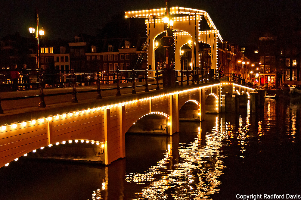 Magere Brug, bridge, at night. Amsterdam, The Netherlands.