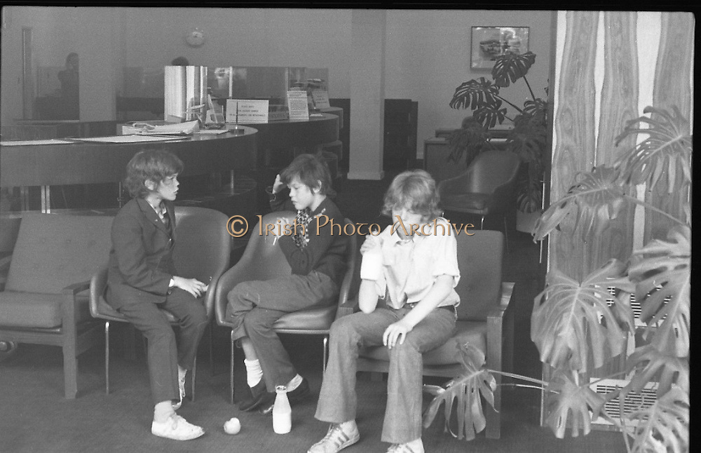 Fergus Rowan sits in at Bank of Ireland.  (J70)..1975..22.08.1975..08.22.1975..22nd August 1975..As a result of the 1970 bank strike which lasted for six months, the Rowan family business found itself in financial difficulties. During the strike the Rowans had had to accept cheques in good faith in order to stay in business. When the cheques came for settlement the bank refused as they stated that some were 'dodgy'. This put severe strain on the business which was eventually put into receivership.As part of the process the Rowan business beside the bank was put up for sale and was purchased by B.o I. Rowan was outraged and started a campaign against the bank which culminated in a sit in at the banks headquarters in Westmoreland St,Dublin. He also became a thorn in the side of the bank at the A.G.Ms raising many points...Time for refreshment, the family are pictured taking a break as they await further outcome.