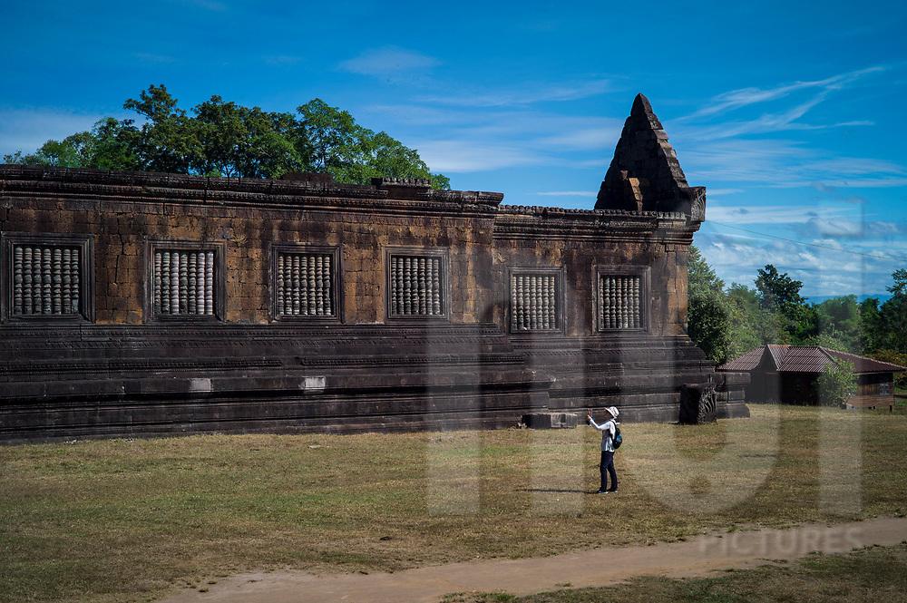 Tourist visiting Vat Phou temple complex (or Wat Phu), Champassak Province, Laos, Southeast Asia