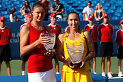CINCINNATI, OH - AUGUST 16: Jelena Jankovic of Serbia and Dinara Safina of Russia following the Western & Southern Financial Group Women's Open on August 16, 2009 at the Lindner Family Tennis Center in Cincinnati, Ohio. Jankovic defeated Safina 6-4, 6-2. (Photo by Joe Robbins)