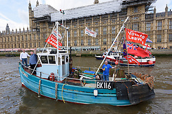 © Licensed to London News Pictures. 15/06/2016. Fisherman in boats outside the Houses of Parliament on the River Thames urging voting in the British EU Referendum.  London, UK. Photo credit: Ray Tang/LNP