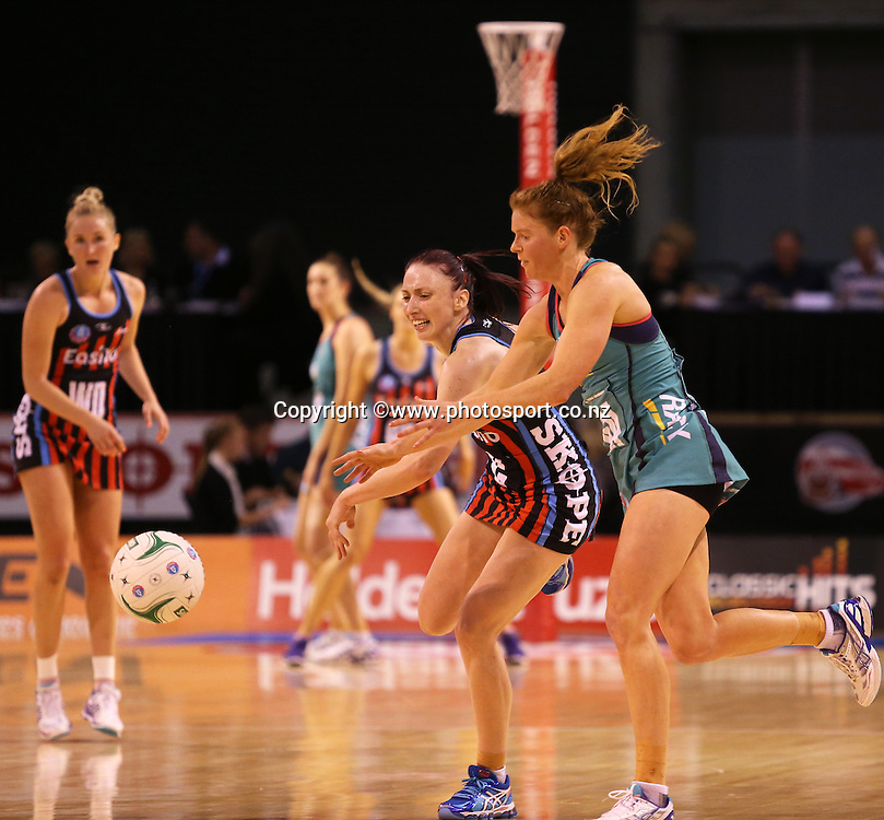 Jade Clarke of the Tactix with the ball and Tegan Caldwell of the Vixens in defence during the ANZ Championship Netball between Mainland Tactix v Melbourne Vixens, held at CBS Arena, Christchurch. 31 March 2014 Photo: Joseph Johnson/www.photosport.co.nz