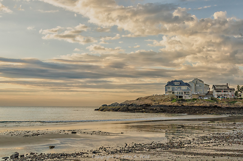 This point on Cape Ann, MA leads to the open ocean.  the last house looking out has the long unobstructed view.  I was fortunate to capture the the wonderful morning light in the clouds as well as the reflections and rocks that come with low tide.  I have taken some liberties in post processing to get the most out of the shot.