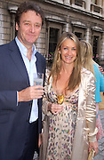 Anya Hindmarch and her husband James Seymour, Around the World in One night, gala to raise money for the Royal Academy,   Royal Academy. 21 June 2004. ONE TIME USE ONLY - DO NOT ARCHIVE  © Copyright Photograph by Dafydd Jones 66 Stockwell Park Rd. London SW9 0DA Tel 020 7733 0108 www.dafjones.com