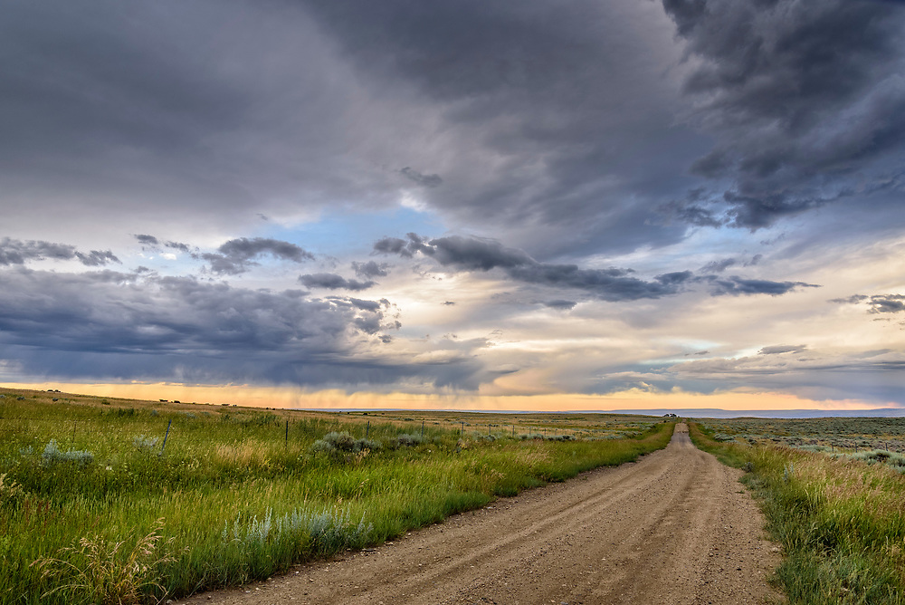 Road and sunset clouds on the sagebrush plateau between Red Lodge and Luther, Montana.