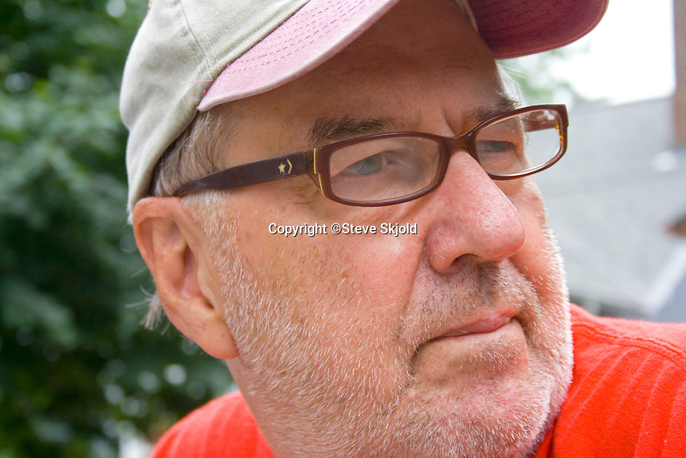 Steve Skjold a wizened old photographer with a serious demeanor. Clitherall Minnesota MN USA