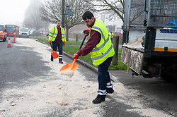 © Licensed to London News Pictures. 23/02/2019. Eltham, Highways maintenance team cleaning up by putting sand over oil and petrol on the road. At approximately midnight a white van failed to stop for police in Eltham. The white van was in collision with a Citreon C3 car despite the best effort of emergency service the male and female occupants were pronounced deceased on scene. Photo credit: Grant Falvey/LNP