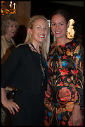 MIEKA SYWAK (L) and REBECCA DAVIES (R) at the preview of LAPADA Art and Antiques Fair. Berkeley Sq. London. 23 September 2014.