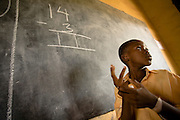 Naphtali Akorli, 8, solves a math problem on the black board during class at the Dahin-Sheli primary school in Tamale, northern Ghana, on Friday June 8, 2007.