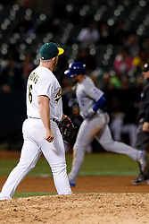 OAKLAND, CA - SEPTEMBER 16: Brett Phillips #14 of the Kansas City Royals rounds the bases after hitting a home run off of Liam Hendriks #16 of the Oakland Athletics during the ninth inning at the RingCentral Coliseum on September 16, 2019 in Oakland, California. The Kansas City Royals defeated the Oakland Athletics 6-5. (Photo by Jason O. Watson/Getty Images) *** Local Caption *** Brett Phillips; Liam Hendriks