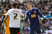 Derby defender Cyrus Christie and Hull goalkeeper Eldin Jakupovic shake hands  during the Sky Bet Championship play-off first leg match between Derby County and Hull City at the iPro Stadium, Derby, England on 14 May 2016. Photo by Aaron  Lupton.