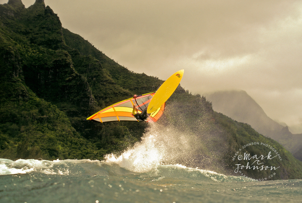 Windsurfing action off of the Na Pali coast, Kauai, Hawaii