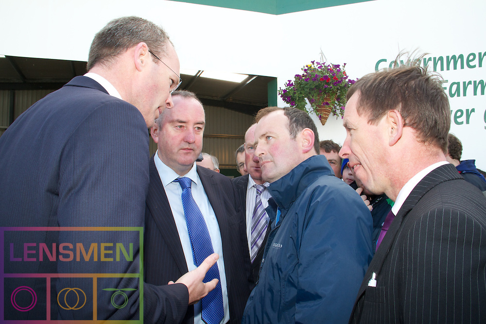 Lensmen Photographic Agency in Dublin, Ireland.<br /> The National Ploughing Championships near Athy, Co Kildare, form.Thursday 22nd September 2011. ..The National Ploughing Championships near Athy, Co Kildare, on 20.09.2011.Simon Coveney TD, Minister for Agriculture, Food and the Marine.....Picture were left to right;.....The National Ploughing Championships and the International Eucharistic Congress National in Ireland are celebrating their 80th anniversaries....The National Ploughing, NPA, IMAGES, www.lensmen.ie, image, it@lensmen.ie, Lensmen Photographic Agency,.