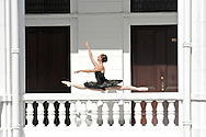 MR. Model relased photo. Ballerina dancing and leaping on a balcony.