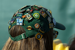 Dana Morgan of Pinole, Calif. sports numerous pins and buttons on her signed cap during Oakland Athletics FanFest at Jack London Square on Saturday, Jan. 27, 2018 in Oakland, Calif. (D. Ross Cameron/SF Chronicle)