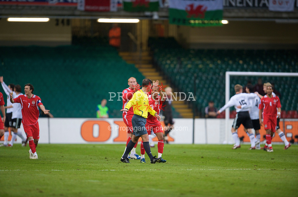 CARDIFF, WALES - Wednesday, April 1, 2009: Wales' Robert Earnshaw and James Collins complain to the referee after Germany's opening goal during the 2010 FIFA World Cup Qualifying Group 4 match at the Millennium Stadium. (Pic by David Rawcliffe/Propaganda)