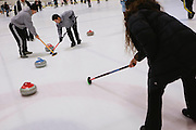 Gabrielle Coleman of Mountain View directs sweepers Brian Zaitz of San Jose, left, and Ryan Winterbourne of San Jose during the San Francisco Bay Area Curling Club's Tuesday night league at Sharks Ice in San Jose on Jan.15, 2013.