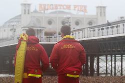 © Licensed to London News Pictures. 02/06/2015. Brighton, UK. Lifeguards standing watch on Brighton Beach. Brighton and the South Coast are being battered by strong wind and big waves. The Lifeguard Service has raised the red flag advising people to stay out the water. today June 2nd 2015. Photo credit : Hugo Michiels/LNP
