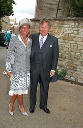 SIR ANTHONY & LADY BAMFORD at the wedding of Hugh van Cutsem to Rose Astor in Burford, Oxfordshire on 4th June 2005.<br />