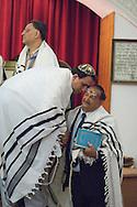 Tehran, Iran. September 13, 2007- Two men talk during the Rosh Hashanah ceremony at Pesyan Synagogue.