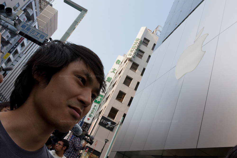 Yosuke Ishinabe, froim Saitama, who started queueing on Tuesday, is first in line at the Apple store awaiting the official release of the iphone4S in Ginza, Tokyo, Japan. Friday October 14th 2011. The latest version of the popular iphone was released worldwide on October 14th. Japans flagship Apple store in Ginza was opened at 8am for the 800 people that had been waiting to be the first to purchase the new telephone.