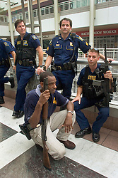 01 Sept, 2005. New Orleans, Louisiana.<br /> Louisiana. Mass evacuation begins. A handful of exhausted and nervous Louisiana State troopers are all that holds 20,000 plus people from the busses. Before evacuees were permitted on the bus the mood was extremely tense with troopers preparing safe exit routes should the crowd simply storm the building in their desperation to reach the busses.<br /> Photo©; Charlie Varley/varleypix.com